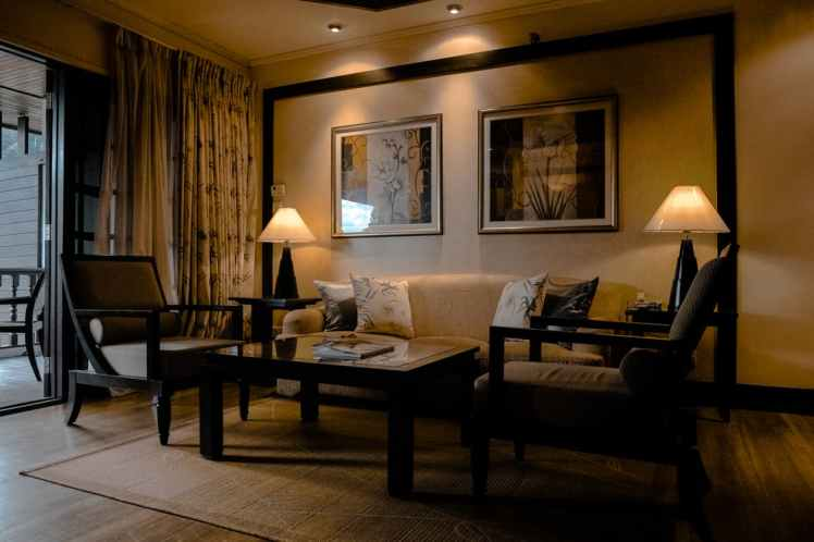 Anibal-Group-RealtyNetWorth-Selling-Open-house-brown-wooden-sofa-set-with-lighted-table-lamp