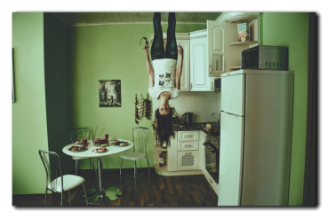 Anibal-Affiliates-Realty-Net_Worth-confused-in-kitchen-hanging-upside-down-2